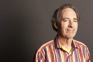 Harry Shearer is wearing a cool striped shirt