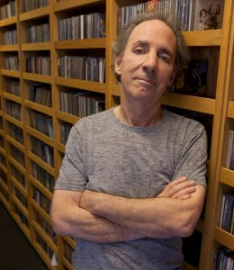 Harry Shearer standing in the KCRW halls