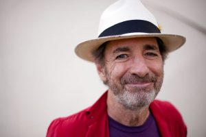 Harry Shearer wearing a white hat