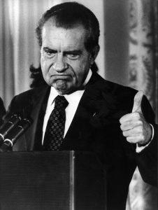 Richard Nixon gives a thumbs up